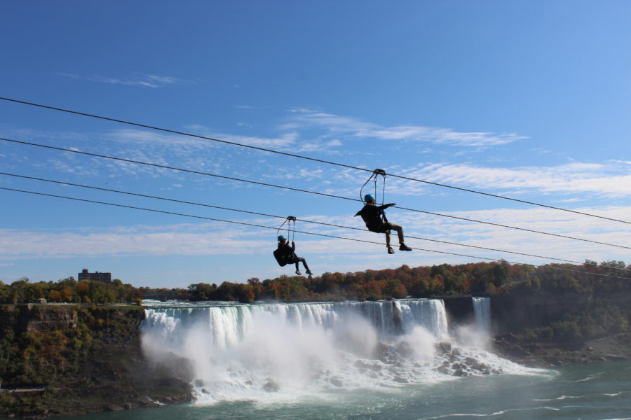 a couple zip lining over Niagara Falls
