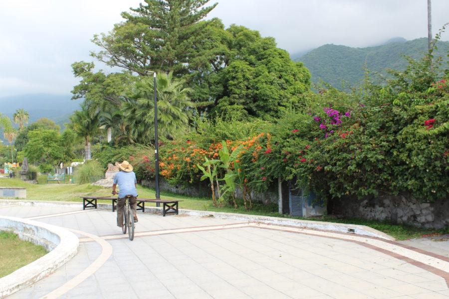 man biking along the malecon in Ajijic